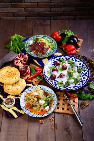 different dishes on a wooden background in Oriental style