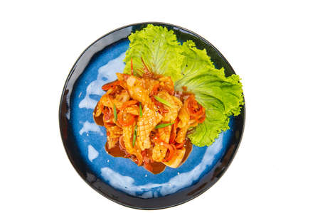 Korean dish made with Squid on a white background