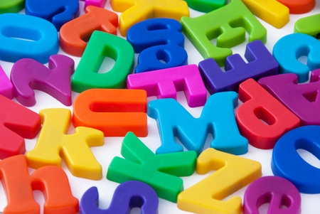 Background image of magnetic alphabet letters photo