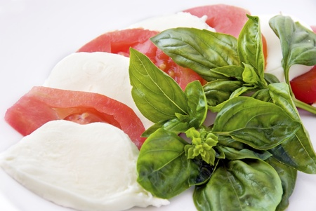 mozzarella, cherry tomatoes and basil om white background photo