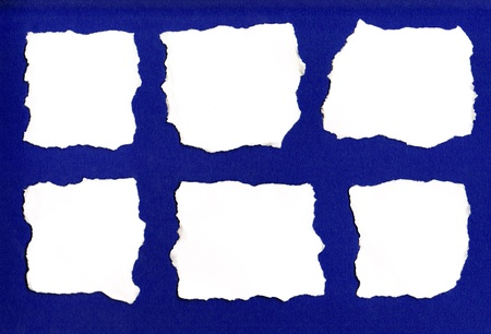 White paper tears isolated on blue background