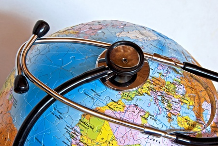 A stethescope on a puzzle globe Stock Photo