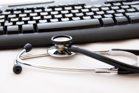 A stethoscope and computer keyboard photo