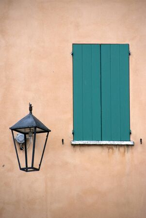 Old wall with green window and street lamp Stock Photo - 10480145
