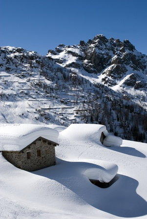 chalets in the snow photo
