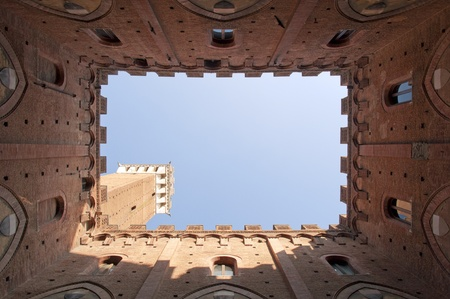 siena: Torre del mangia in siena It is a famous tower in Siena, Italy Stock Photo