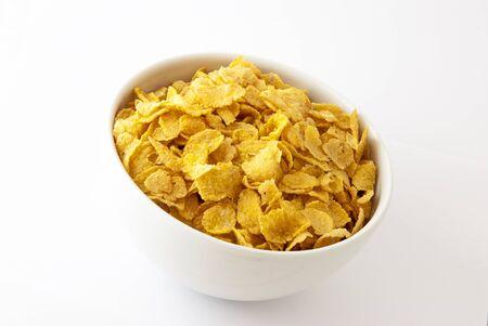 corn flakes: cornflakes in bowl on white background