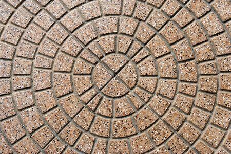 empedrado: pavimento con adoquines de forma circular
