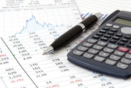 Financial objects  Stock chart,  calculator and pen photo