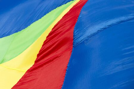 A colorful fabric with red, yellow, blue and green  stripes for background use photo
