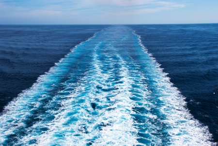 wide wet: Wake in the ocean made by cruise ship Stock Photo