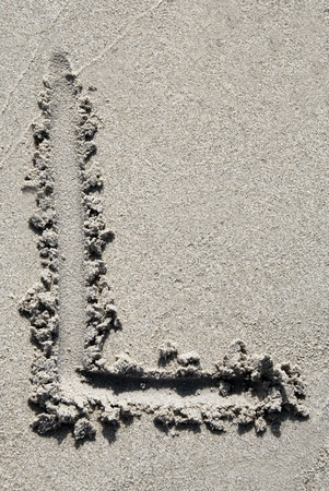 The Letter L Of Alphabet Writing On Sand Beach Stock Photo Picture And Royalty Free Image 14585729