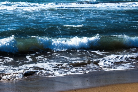 breaking wave: Blue sea with waves  in Sardinia, Italy, caused by mistral wind