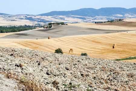 val d'orcia: Beautiful tuscany landscape with farm and fileds