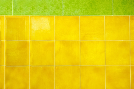 green and yellow tiles on a wall photo