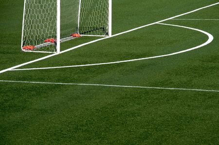 play ground: A detail of a soccer field grass with net Stock Photo