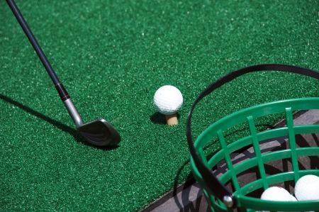 driving range: A golf ball and a driver in a practice club Stock Photo