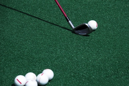 driving range: golf ball and driver  in a practice club Stock Photo