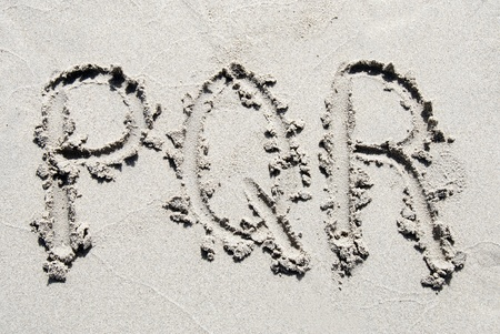 sand writing: The letters P, Q and R of the alphabet writing on the sand beach