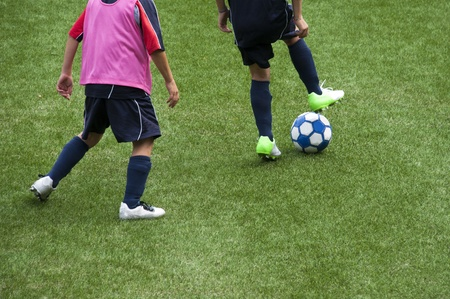 kids club: Young kids playing soccer game