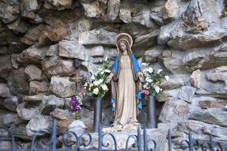 The statue of the Virgin Mary in a stone cave photo