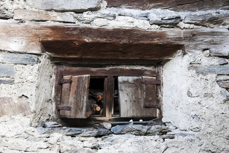 Window of a old cottage in the Alps mountains photo