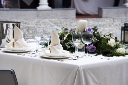 Romantic table setting for two with a bouquet of roses photo
