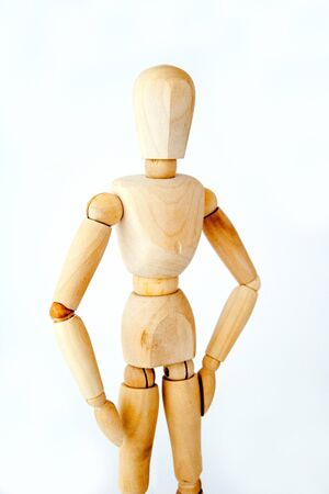 manequin: wooden mannequin isolated on white background