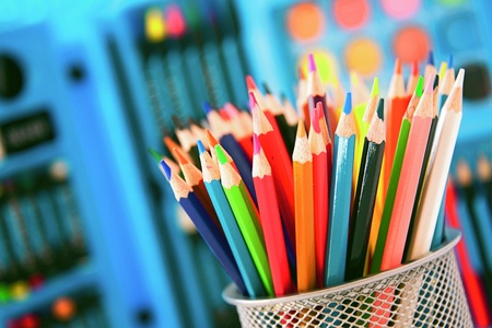 descriptive colours: colored pencils and crayons  Other art tools in the background  Stock Photo