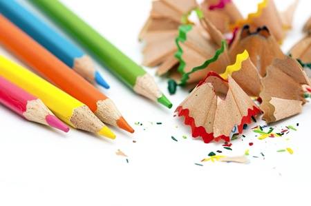 colorful pencils and pencils shaving on white background photo