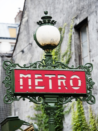 A traditional metro sign in Paris- France photo