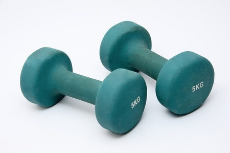kg: Two green  dumbbell isolated on white