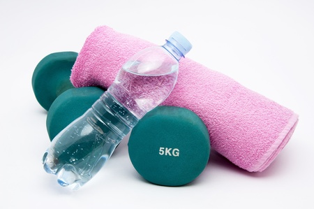 water aerobics: Fitness  concept - dumbbells, water bottle and towel
