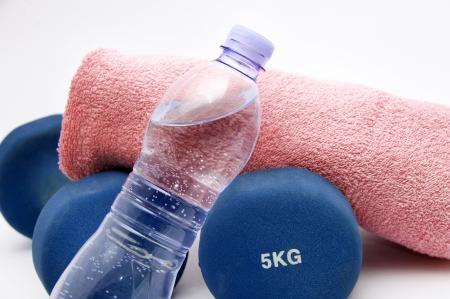 kg: Fitness  concept - dumbbells, water bottle and towel