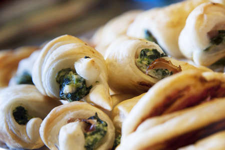 spinage: A plate of puff pastry snack with spinach Stock Photo