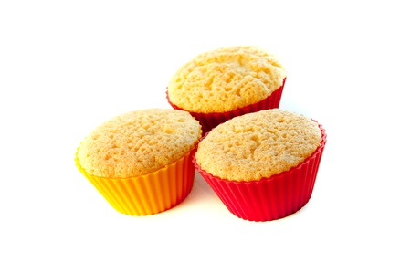 Three tasty muffin cakes on a white table Stock Photo - 18095284