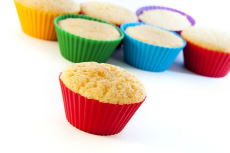 Tasty muffin cakes isolated on white photo