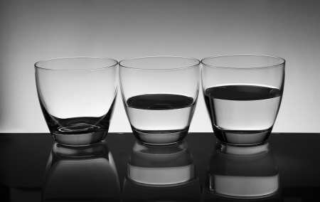 glasses  with water on gray  background Stock Photo - 18757663