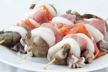 prawn skewers: Tuna and salmon skewers with prawns and squid Stock Photo