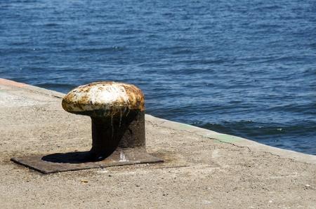 bollard: Old bollard on a pier