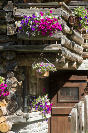 A cottage  with flowers decoration photo