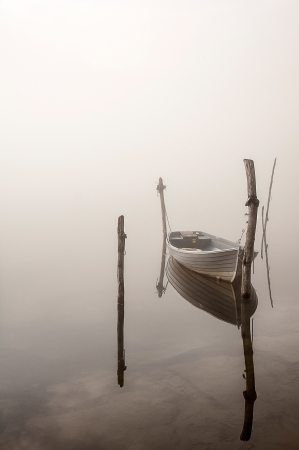 small boat: boat in the fog