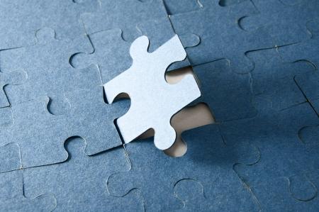 Last piece of jigsaw puzzle - blue tone photo
