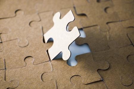 Last piece of jigsaw puzzle - golden tone photo