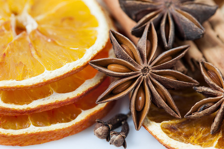 Sliced dried orange with  anise stars and cloves