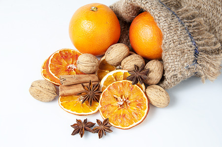 cinnamon bark: Christmas spices. Cinnamon sticks, anise stars, walnuts and sliced of dried orange Stock Photo