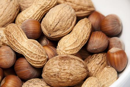 mixed nuts - hazelnuts, walnuts and peanuts photo