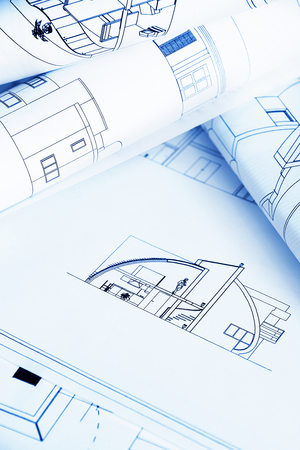 Architectural background with blueprints - blue tone photo