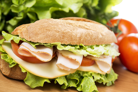 chicken breast sandwich with salad, cheese and tomatoes photo