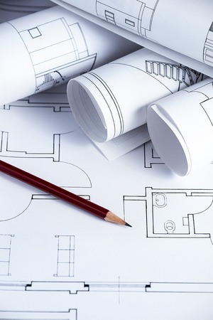 autocad: Architect worplace with blueprints and pencil